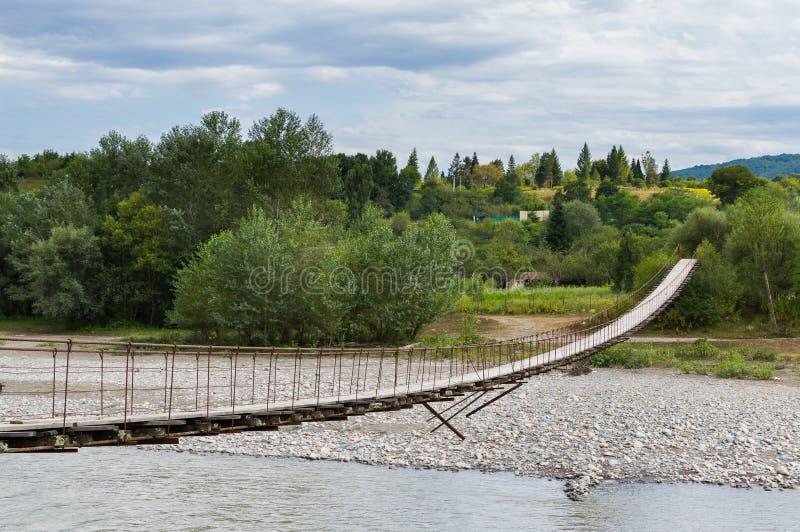 Suspension cable bridge, Crossing the river. Adygea republic, Krasnodar region, Russia. Suspension cable bridge, Crossing the river, ferriage in the woods royalty free stock photo