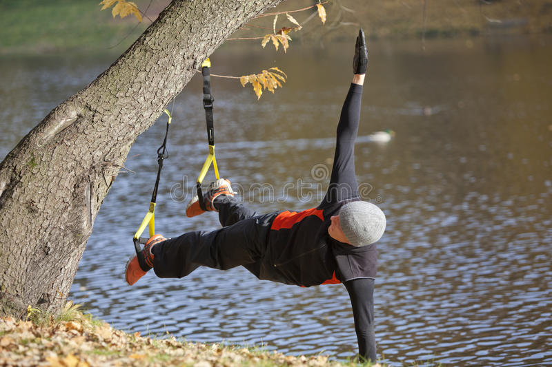 Download Suspension Workout  At The River Stock Photo - Image: 18799128
