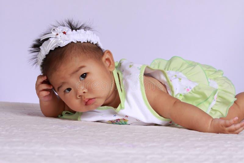 Suspicious Asian Baby stock photography