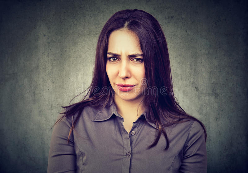 Suspicious doubtful young woman stock photography