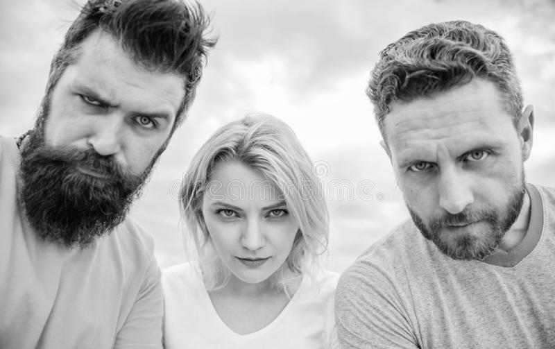 Suspicious look. They know what you did. Threesome suspiciously look down. Woman and men look confident sky background. Strength in unity. Stand up for their stock image