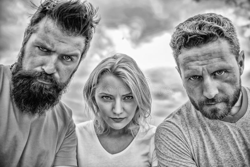 Suspicious look. Threesome suspiciously look down. Woman and men look confident sky background. Strength in unity. Stand royalty free stock images