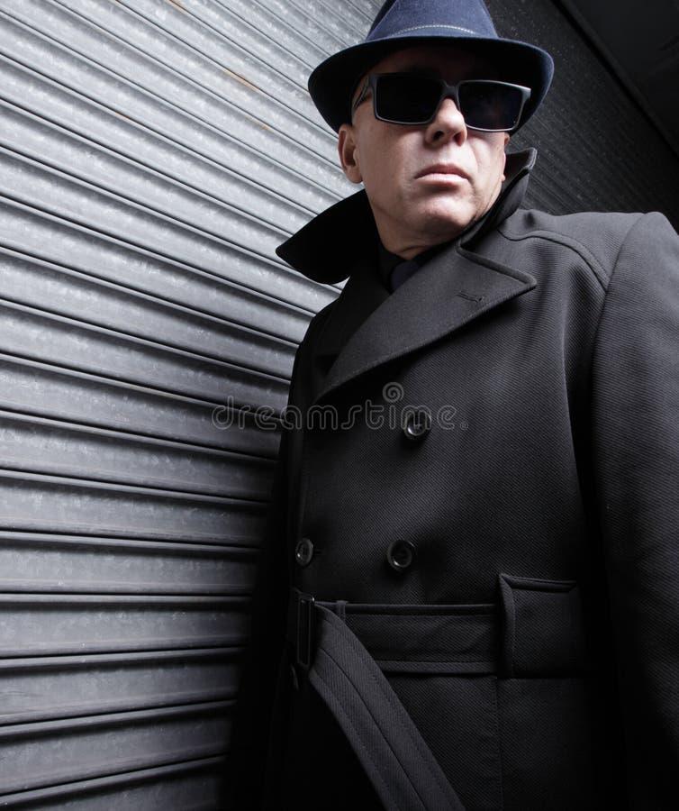 Suspicious man stock photos