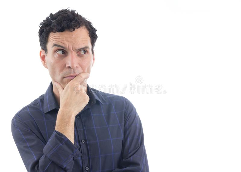 Suspicious man. The person is wearing dark blue social shirt. Is royalty free stock photography