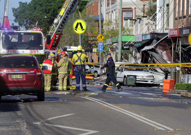 Suspicious shop blast explosion in Rozelle Sydney. ROZELLE, AUSTRALIA - SEPTEMBER 4, 2014; Firefighters and rescue crew discuss an action plan for a search and royalty free stock photos