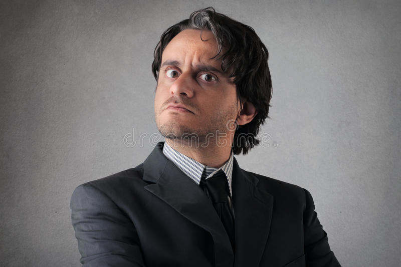 Download Suspicious Young Businessman Stock Photo - Image of male, expression: 39504638