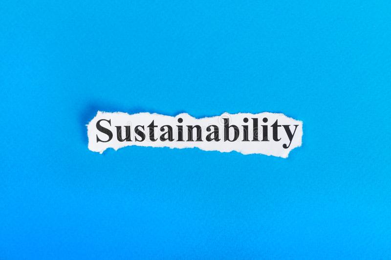 Sustainability text on paper. Word Sustainability on torn paper. Concept Image stock images