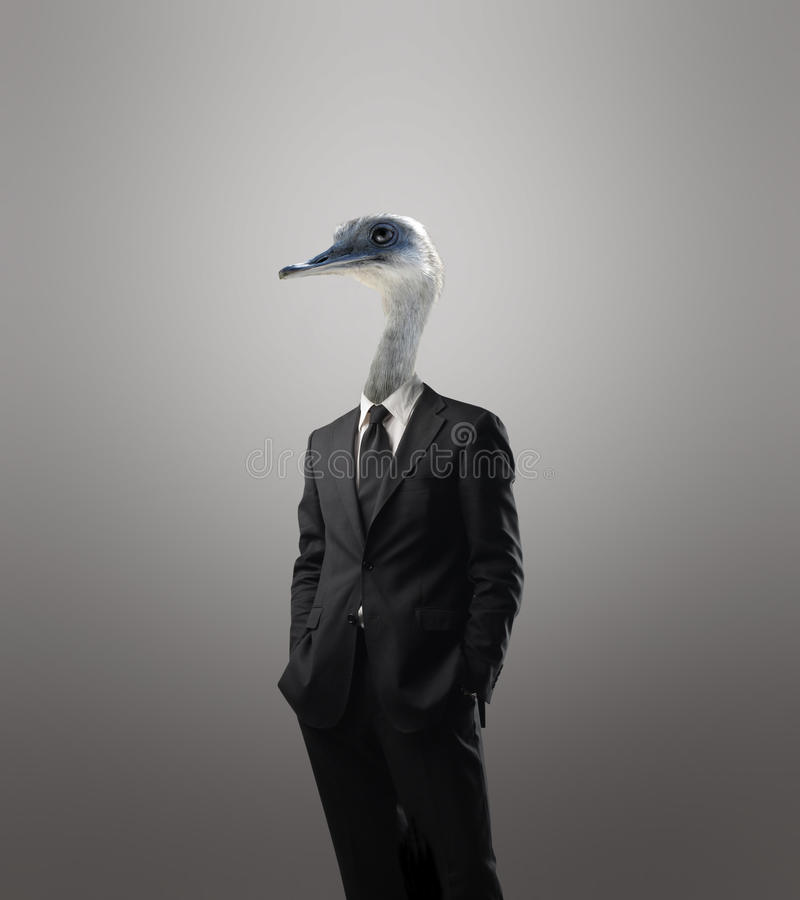Sustainable development. Businessman with the head of a bird instead of his head