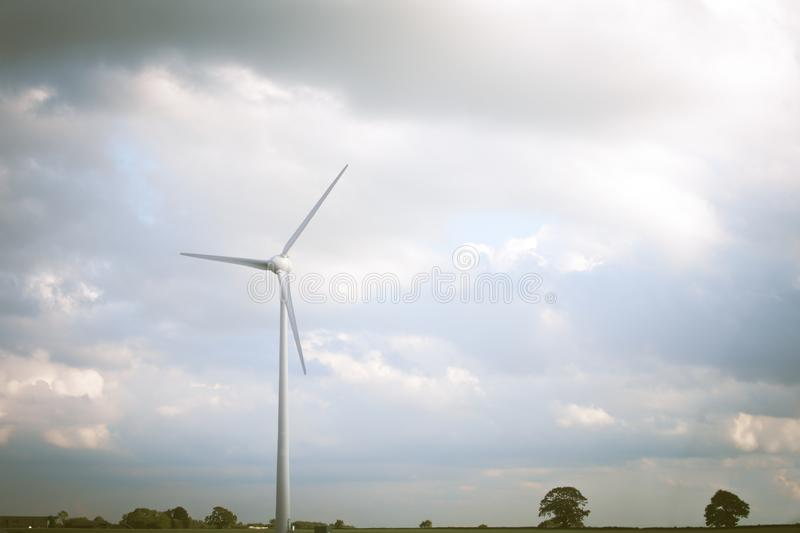 Sustainable energy production from natural renewable resources. Wind farms and turbines royalty free stock photo