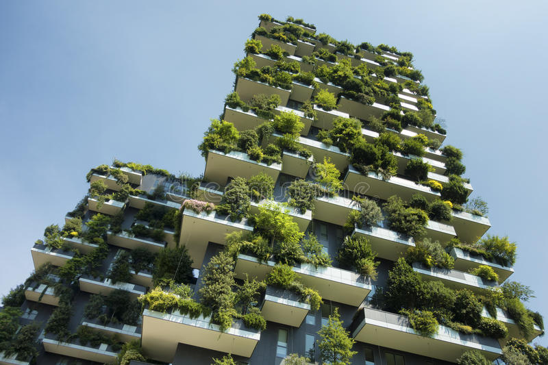 Sustainable green building. Sustainable construction, modern green building royalty free stock images