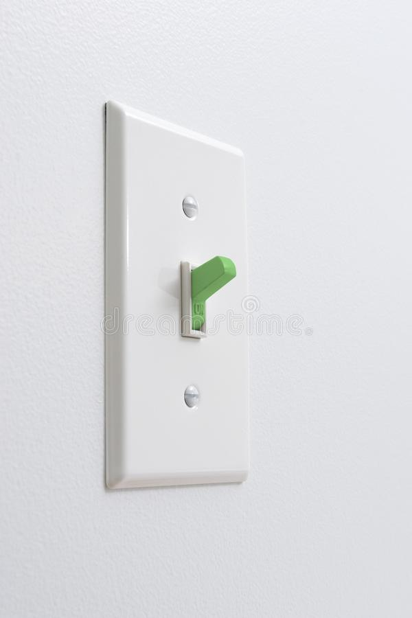 Sustainable green energy light switch royalty free stock image
