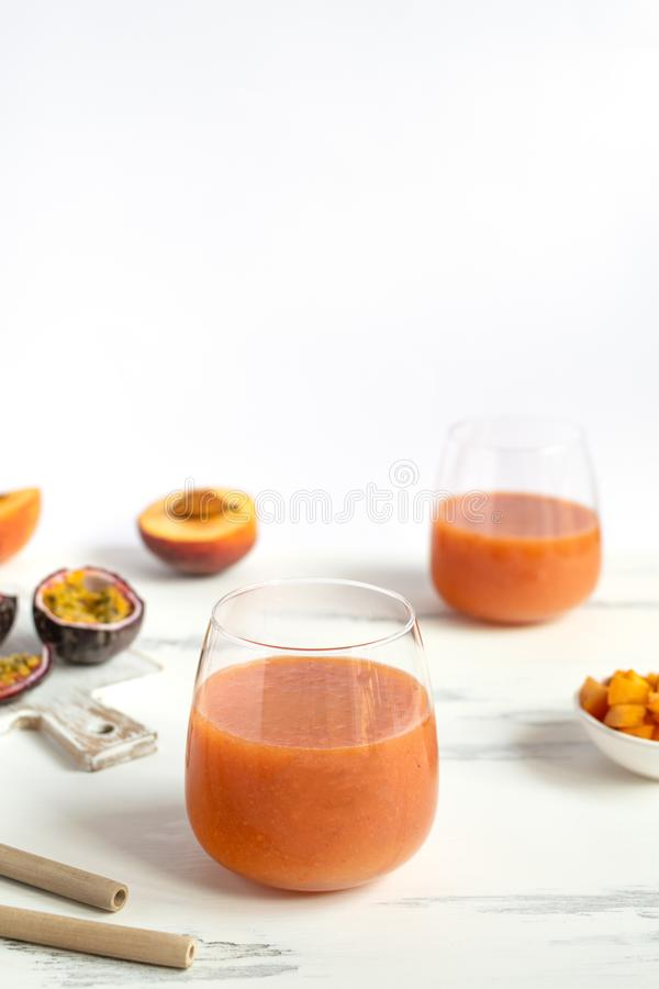 Peach and passion fruit smoothie with bamboo drinking straw. Sustainable lifestyle, plastic free - peach and passion fruit smoothie with bamboo drinking straw stock images