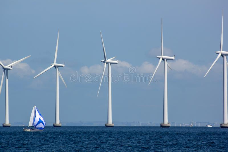 Sustainable Offshore Windfarm with Sailboat stock image