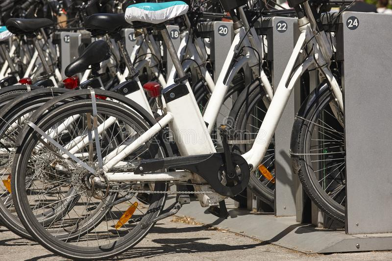 Sustainable urban mobility. Bikes on the city. Electric transport. Traffic royalty free stock photo
