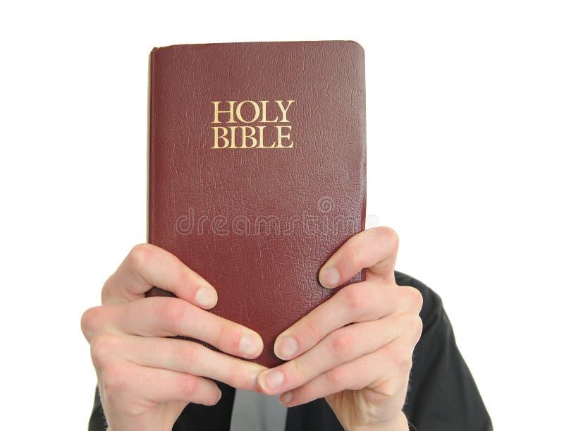 Sustentando a Bíblia foto de stock royalty free