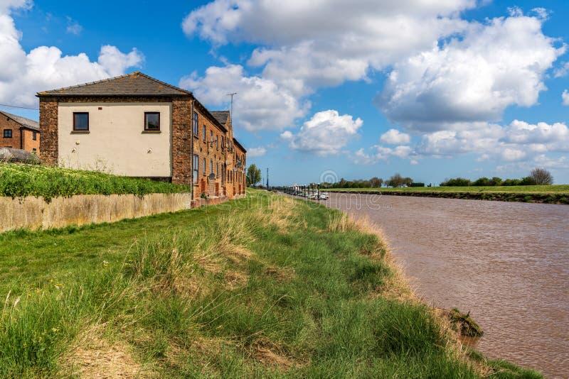 Sutton Bridge, Lincolnshire, England. UK - April 26, 2019: Houses near the River Nene royalty free stock photography