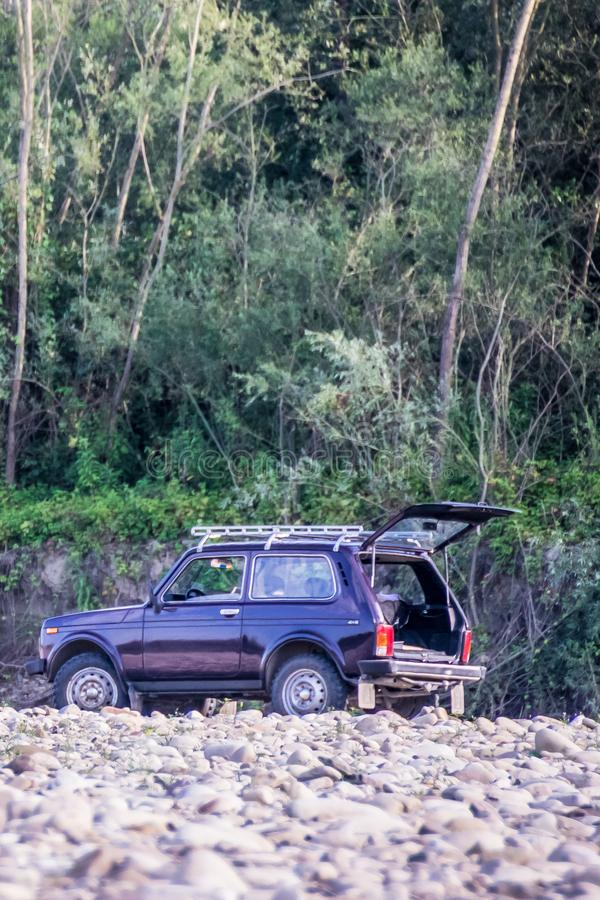 SUV camping on the nature. Compact SUV camping on the nature. Famous russian folk four wheel drive car Lada Niva 4x4 or VAZ-2121. Serial production since 1977 stock photography