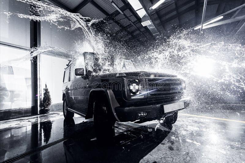 SUV car at the carwash. SUV car at the car wash, the water splashes, the interior stock photo