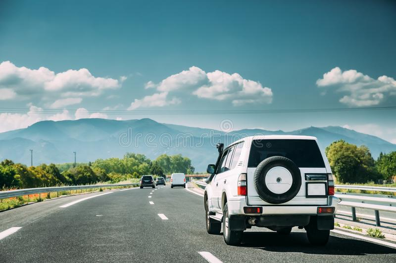 SUV Car Driving In Motorway Highway Freeway Road With Mountains Landscape On Background. Auto Travel Trip Concept royalty free stock image