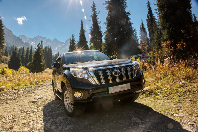 Suv car mountains. SUV car in the mountains Small Almaty gorge stock photography