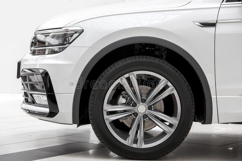 The SUV car a side view. The car a side view on a wheel, the SUV of white color royalty free stock photography