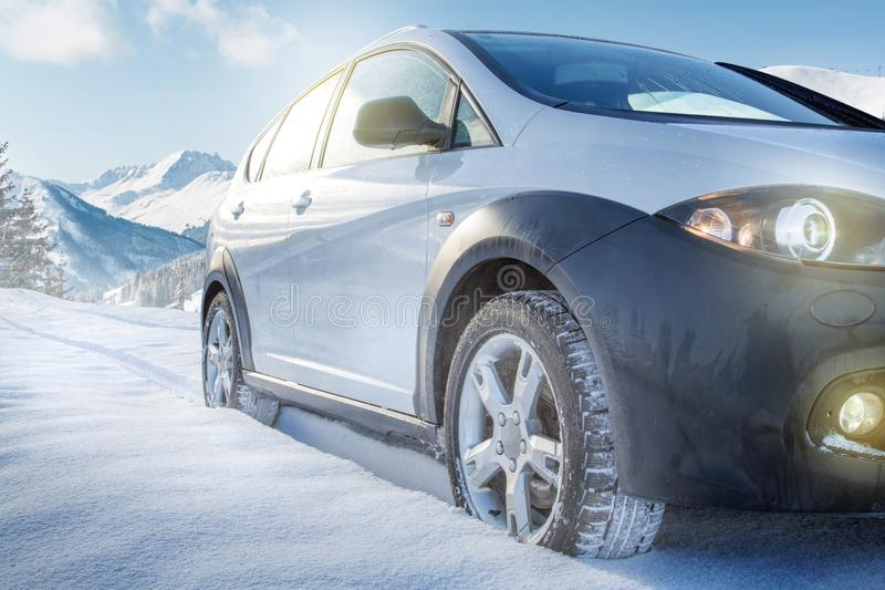 SUV car on snow covered mountain road royalty free stock image