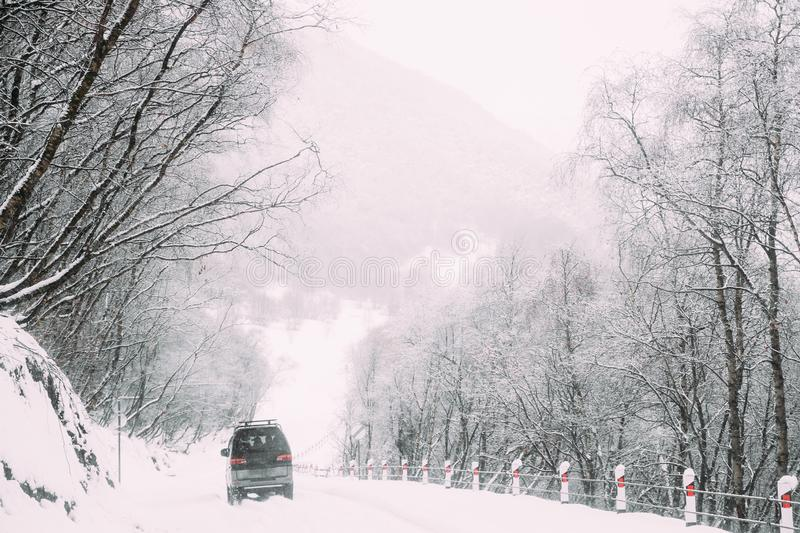 SUV Car On Snowy Road In Winter Hills Mountains Landscape, Georgia. Drive And Travel Concept. Snowy Land Road At Winter stock photo