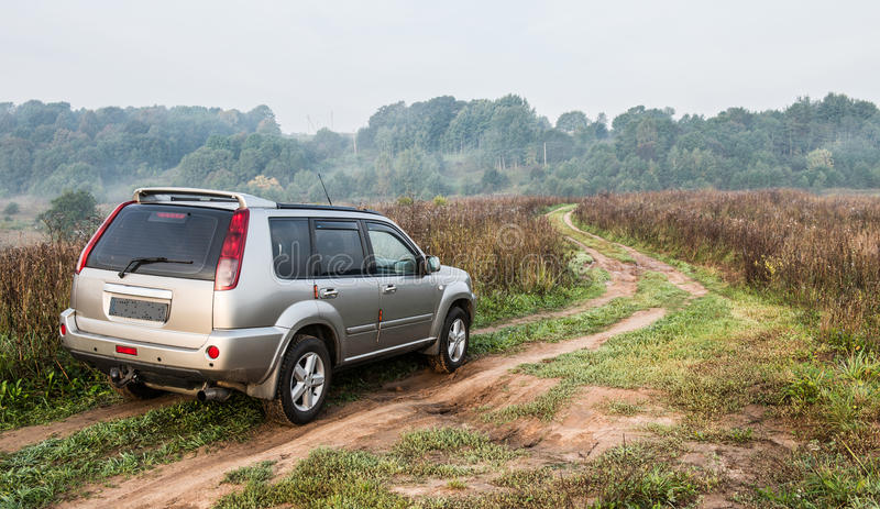 Suv in countryside road. Suv drive in countryside mud road royalty free stock photography