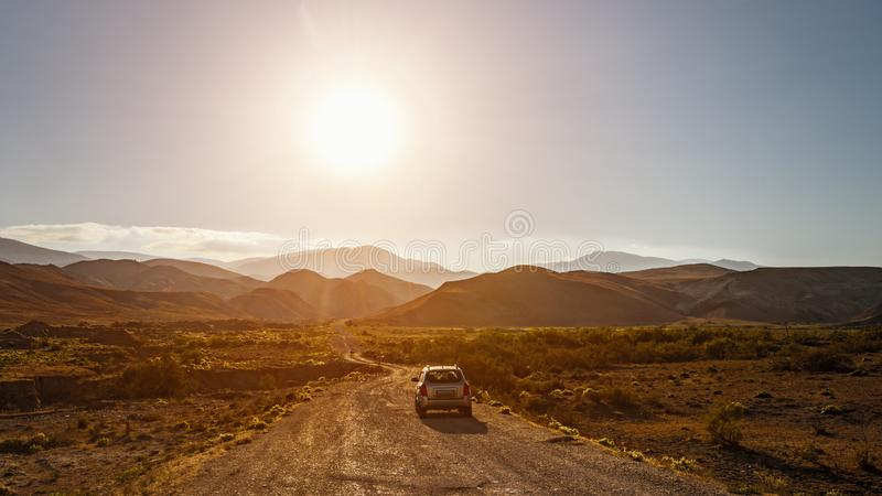 SUV on a dirt mountain road stock photo