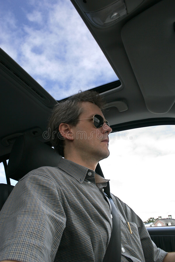 SUV Driver. Male SUV driver under blue sky royalty free stock photos
