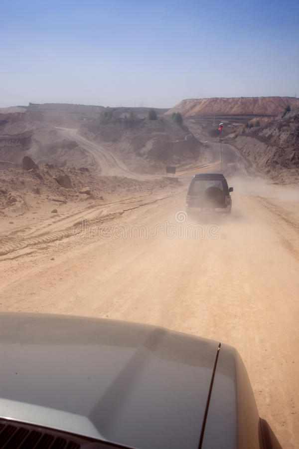 Download SUV Driving Off Road At Mining Site Stock Image - Image: 25518137