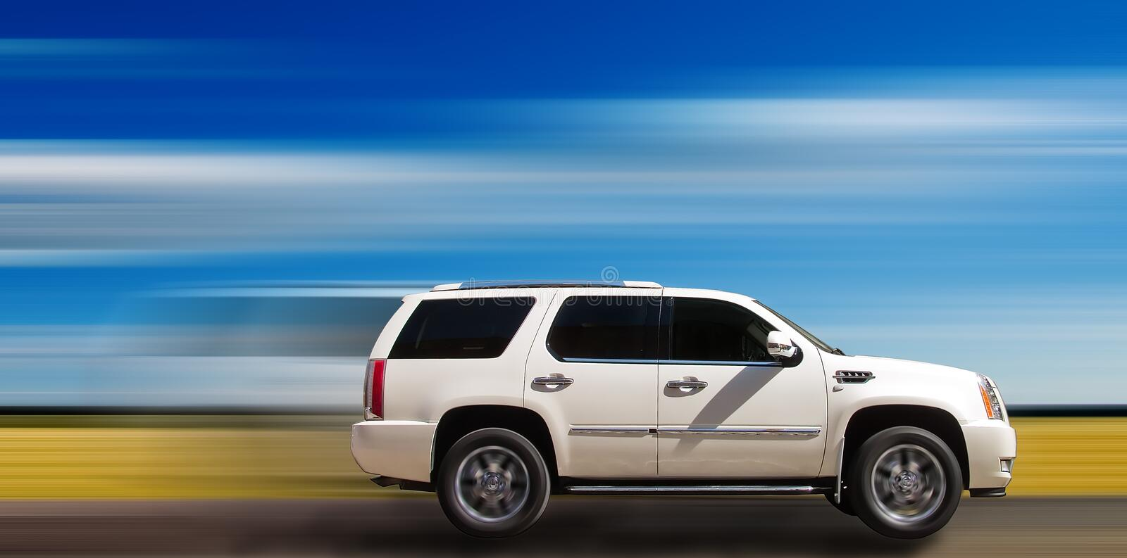 SUV on motion background. White SUV driving on the highway with blue motion background