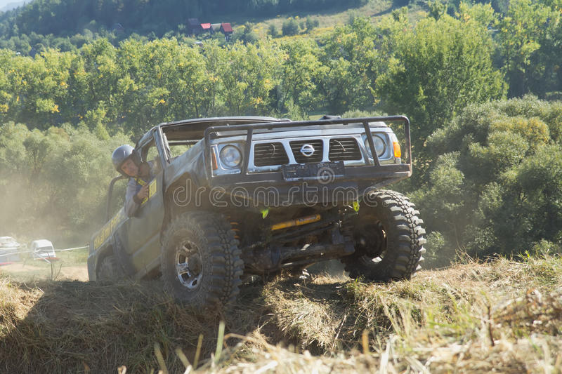Download SUV Is Overcoming A Terrain Obstacles. Editorial Stock Photo - Image: 33600078
