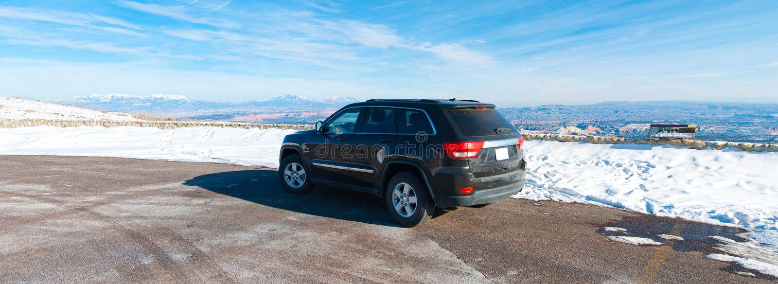 SUV parked off road. An SUV parked on a vista point in Utah royalty free stock photos