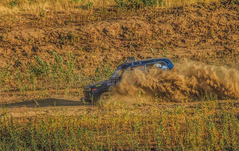 Off-road dust on the race royalty free stock photography