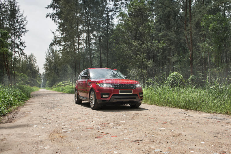 Suv. A red suv parked in a forest stock photo