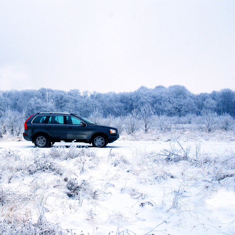 SUV In Winter Countryside Royalty Free Stock Image