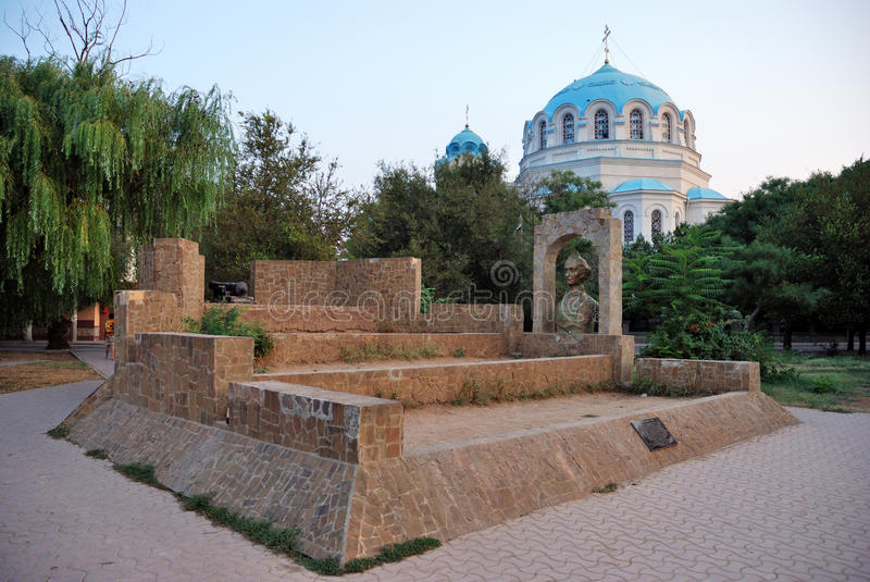 Suvorov redoubt against the St. Nicholas Cathedral in Yevpatoriya. Monument to the Russian commander A.V. Suvorov against the domes of St. Nicholas Cathedral in royalty free stock photos