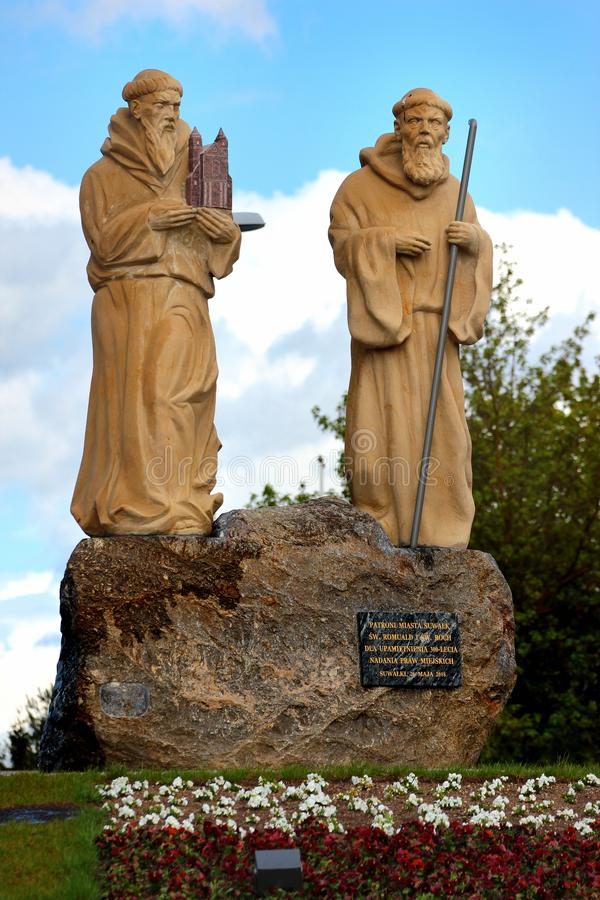 Statues of Saint Roch and Saint Romuald in Suwalki, Poland. Suwalki, Poland - May 3, 2019: Statues of Saint Roch and Saint Romuald, the patrons of Suwalki town stock photography
