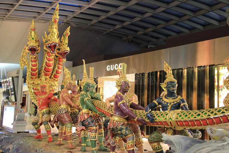 Suwanabhumi Airport. Bangkok, Thailand - December 29, 2013: Sculpture of Churning of the Ocean of Milk is the main decoration at Departure Area at Suwanabhumi stock images