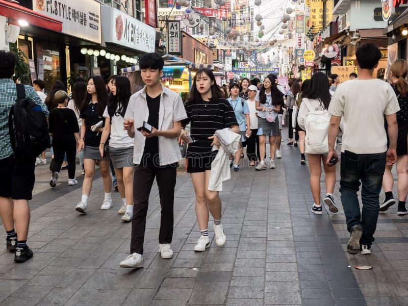 Suwon, South Korea - June 15, 2017: Young couple walking along the main street in Suwon.  stock photos