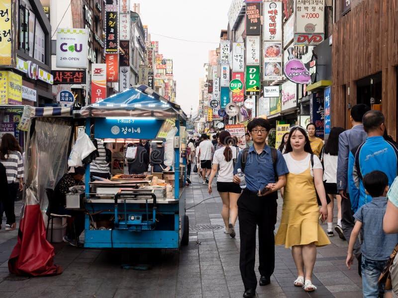 Suwon, South Korea - June 15, 2017: Young korean couple walking along the main street in Suwon.  royalty free stock photography