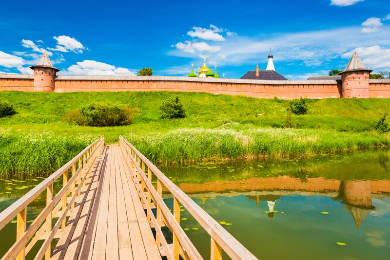 Suzdal cityscape with old Russian architecture, Russia. Suzdal cityscape with old Russian architecture. Wooden bridge across the river. The Golden Ring of Russia royalty free stock image