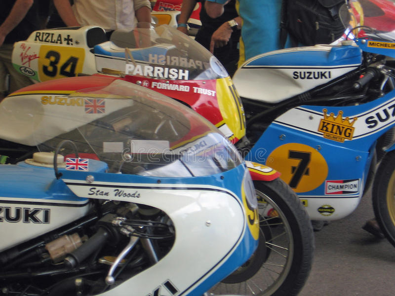 Suzuki Grand Prix motorcycles at the 2009 Goodwood Festival of Speed. Iconic Grand Prix motorcycles of Barry Sheene, Steve Parrish and Stan Woods in the race stock photos