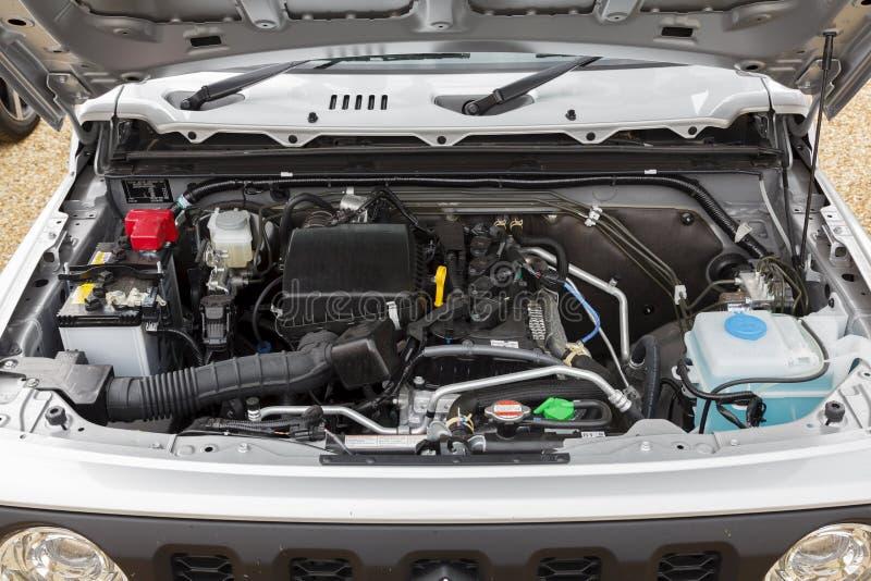 Suzuki Jimny car engine. Buckingham, UK - May 16, 2019. Engine compartment underneath the hood or bonnet of a 2019 Suzuki Jimny. The engine is a 1.5L petrol royalty free stock photo