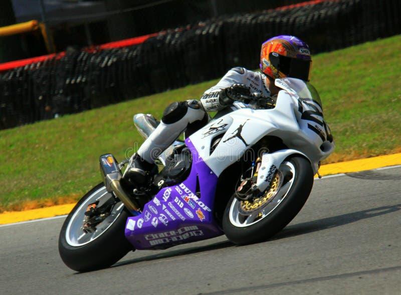 Suzuki que compite con la bici fotos de archivo