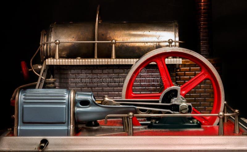 Svänghjul av en ångamotor arkivfoto
