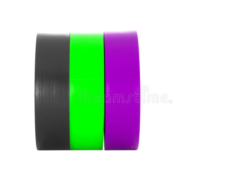 Svärta, göra grön, purpurfärgade isolera bandrullar som isoleras på vit bakgrund arkivfoto