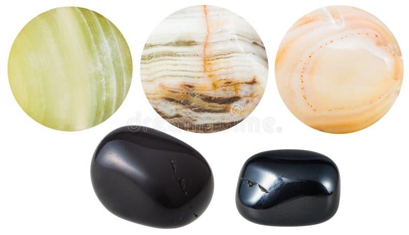 Svärta och marmorera naturliga mineraliska ädelstenstenar för onyx royaltyfri fotografi