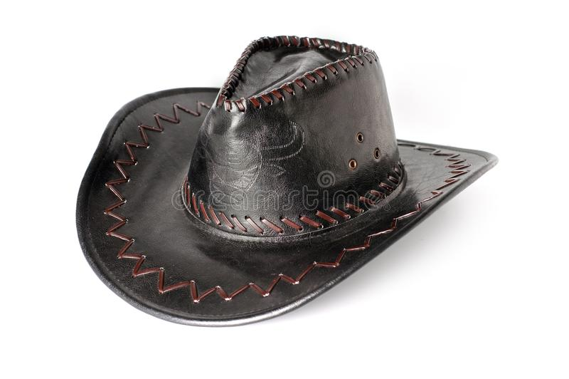 Svärta, piska, tappningcowboyhatten på en vit bakgrund arkivbild